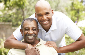caregiver and elderly patient smiling