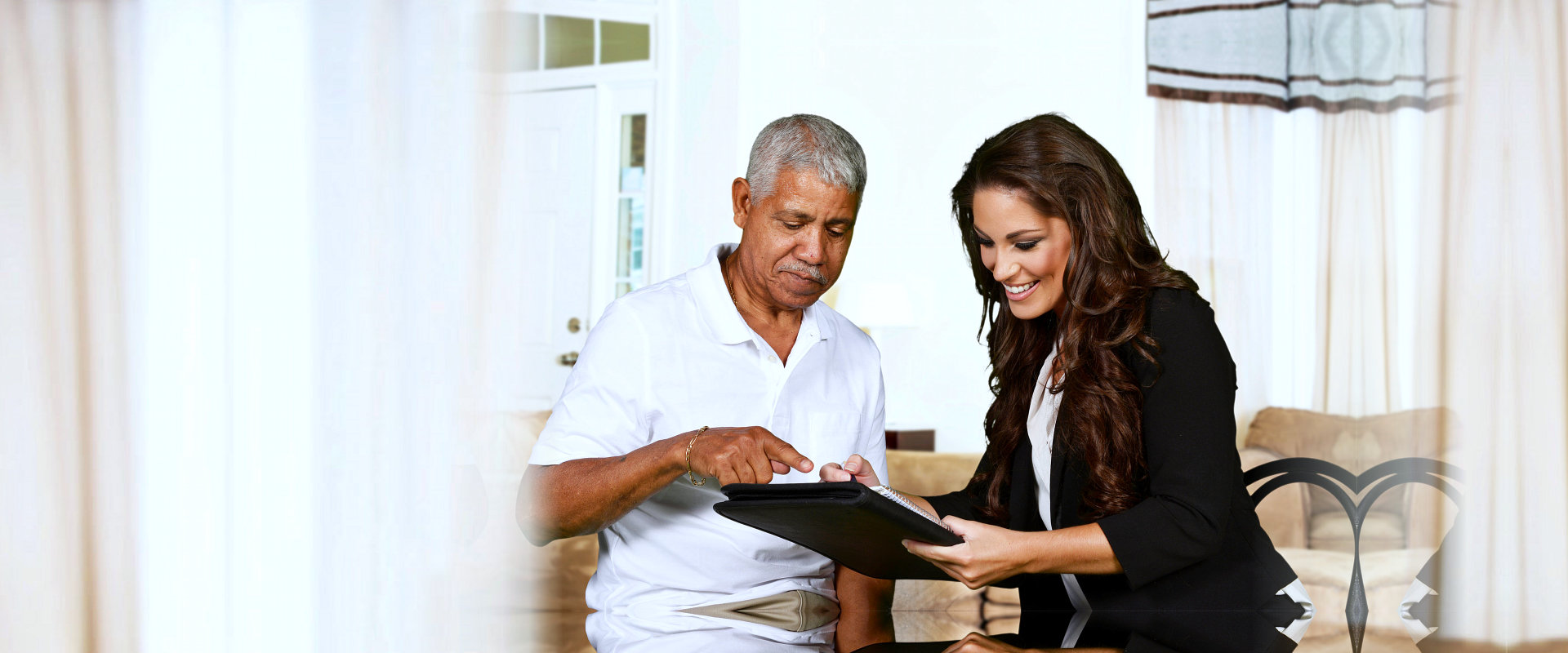caregiver showing some documents to elderly patient