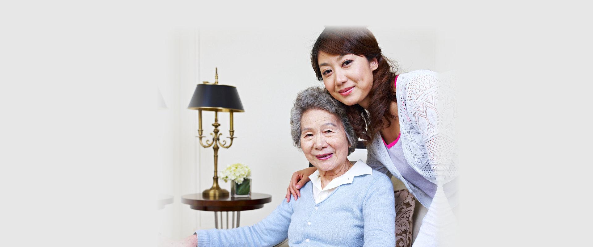 caregiver holding the shoulder of elderly patient